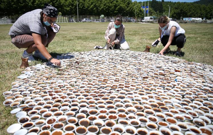 Traveling coffee-cup memorial for Srebrenica's dead comes home