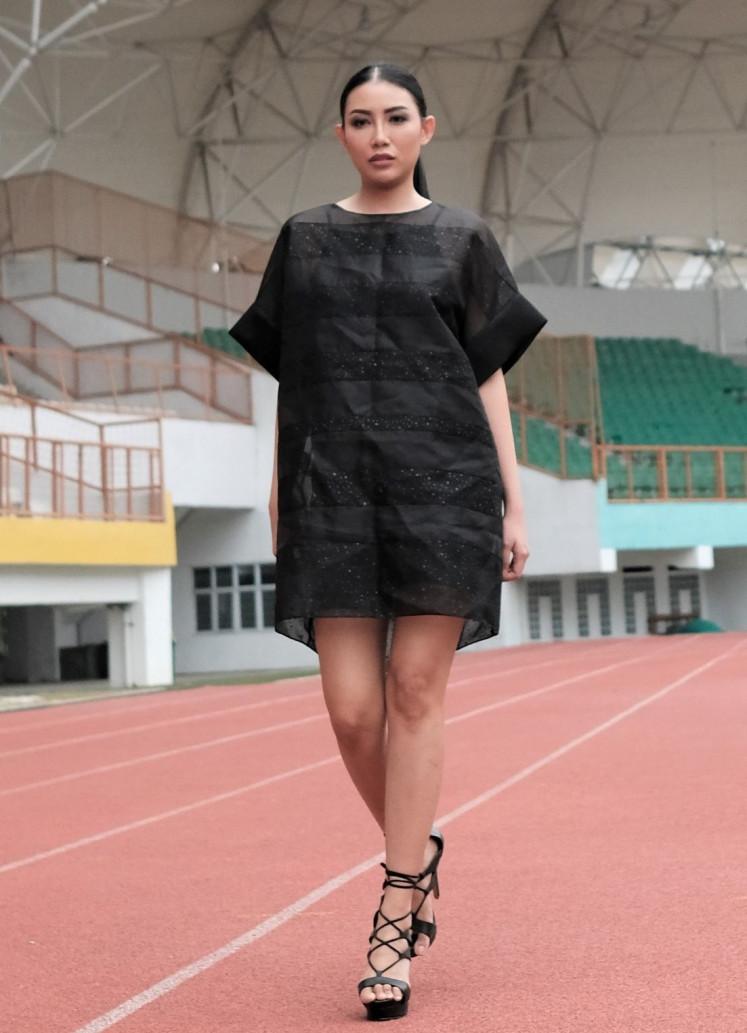 Back in black: Designer Yosafat Dwi Kurniawan keeps the silhouette simple, utilizing minimalist embellishment for a clean look.