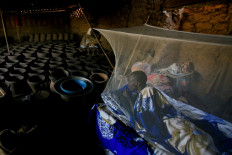 Peter Majak, a pottery maker from South Sudan, rests under a mosquito net inside a traditional pottery factory close to the banks of the Nile river, in Alqamayir, Omdurman, Sudan, February 17, 2020. Reuters/Zohra Bensemra