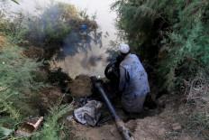 Ahmed Mohamed, a mechanic and farmer, fixes a water pump machine near the banks of the Blue Nile River on Tuti Island, Khartoum, Sudan, February 20, 2020. Reuters/Zohra Bensemra