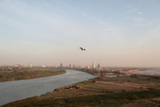 A bird flies over the convergence between the White Nile river and Blue Nile river in Khartoum, Sudan, February 17, 2020. Reuters/Zohra Bensemra