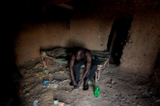 David Plantino, 35, a pottery maker from South Sudan, puts on shoes at his shelter where he sleeps during the week, as he gets ready to go to work in Omdurman, Sudan, February 18, 2020. Reuters/ Zohra Bensemra
