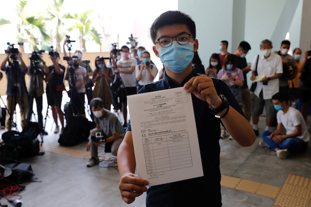 Under Beijing's watchful eye, Joshua Wong treads fine line