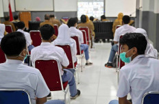 Students of SMA 1 state senior high school in Bogor, West Java, attend the school's orientation program on the first day of school on July 13. To prevent the virus from spreading, learning activities for schools in Bogor are still being held virtually. - JP/P.J.Leo