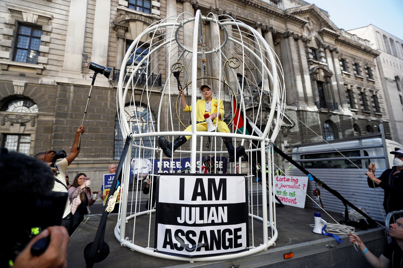 Caged like a 'canary', Vivienne Westwood protests for Assange in London
