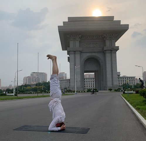 Headstands in N.Korea: Swedish ambassador takes yoga to streets amid coronavirus lockdown