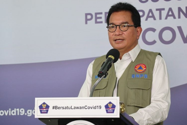 Wiku Adisasmito of the national COVID-19 task force speaks in a press briefing.