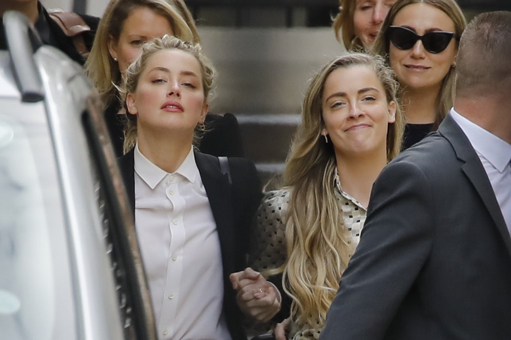 Video of Amber Heard's sister shows actress 'beat' her, Depp trial hears