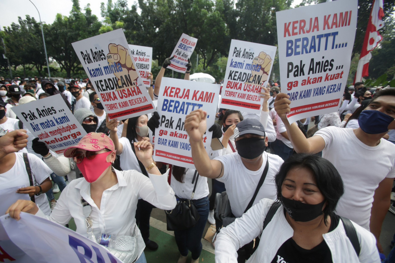 Hundreds of entertainment industry business owners and workers grouped under the Jakarta Association of Entertainment Entrepreneurs (Asphija) hold a rally in front of Jakarta City Hall on July 21. They urged the city administration to allow them to reopen their businesses. JP/Wendra Ajistyatama