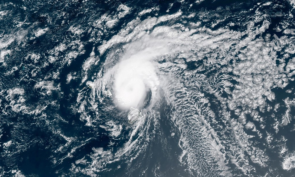 Douglas threatens Hawaii as Hanna downgraded to tropical storm