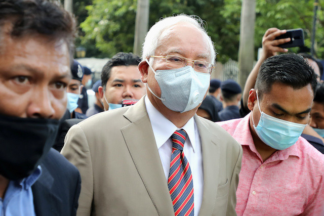 Malaysia's Najib sentenced to over a decade in jail in first 1MDB graft trial