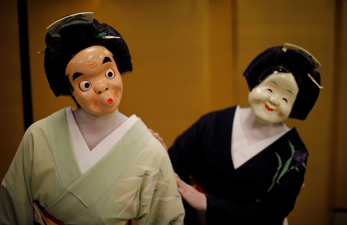 Maki and Ikuko, who are geisha, perform a dance routine for Reuters, as they wait for customers to arrive, who are hosting a party where they will be entertaining with other geisha, at Asada, a luxury Japanese restaurant, during the coronavirus disease (COVID-19) outbreak, in Tokyo, Japan, June 23, 2020. Reuters/Kim Kyung-Hoon