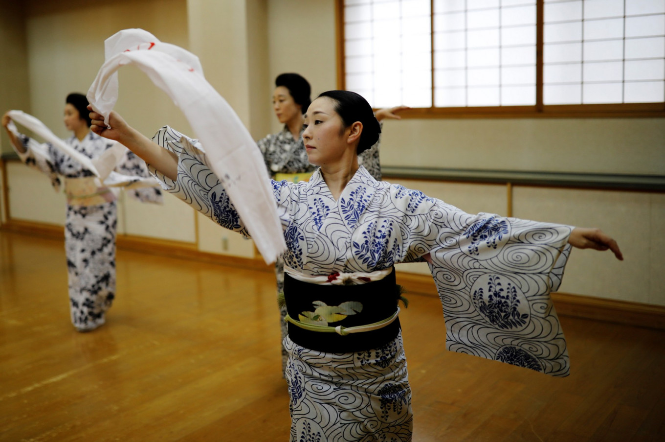 Koiku, Maki, Ikuko and Mayu, who are geisha, perform a dance routine for Reuters, before they work at a party being hosted by customers at Asada, a luxury Japanese restaurant, during the coronavirus disease (COVID-19) outbreak in Tokyo, Japan, June 23, 2020. Reuters/Kim Kyung-Hoon