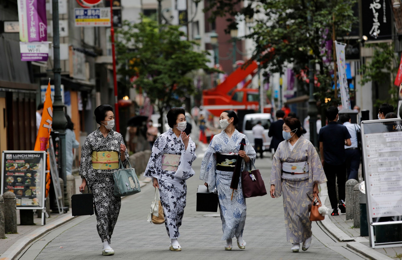 "Maki, Mayu, Koiku and Ikuko, who are geisha, wear protective face masks as they walk to a restaurant after attending a dance class, during the coronavirus disease (COVID-19) outbreak, in Tokyo, Japan. July 13, 2020. Ikuko fears an extended pandemic could prompt some geisha to quit. ""Now is the worst of the worst"", she said. ""How are we going to get through? It'll take all of our body and   soul."" Reuters/Kim Kyung-Hoon"