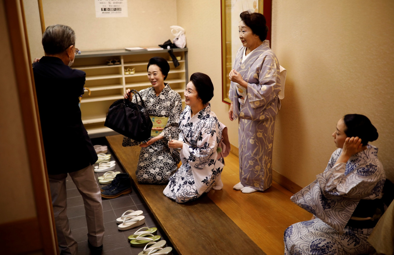 Maki, Mayu, Ikuko and Koiku, who are geisha, greet Fujima Hideka, a dance master of Japanese traditional dance, after attending a   dance class for geisha only, during the coronavirus (COVID-19) outbreak, in Tokyo, Japan, July 13, 2020. Reuters/Kim Kyung-Hoon