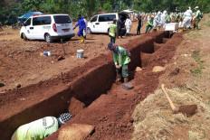 Gravediggers at Pondok Ranggon Cemetery in East Jakarta prepare burial sites for deceased COVID-19 patients on July 27. JP/P.J.Leo