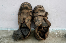 Shoes belonging to Mansoor Khan, a waste collector, are left outside of his home, next to a landfill site, during the coronavirus disease (COVID-19) outbreak, in New Delhi, India, July 16, 2020. Reuters/Adnan Abidi