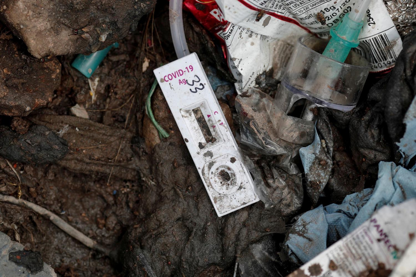 A COVID-19 testing kit lies on the floor at a landfill site, during the coronavirus disease (COVID-19) outbreak, in New Delhi, India, July 22, 2020. Reuters/Adnan Abidi