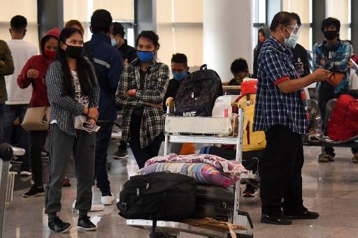 Broke and helpless: Philippines virus lockdown maroons dozens at airport