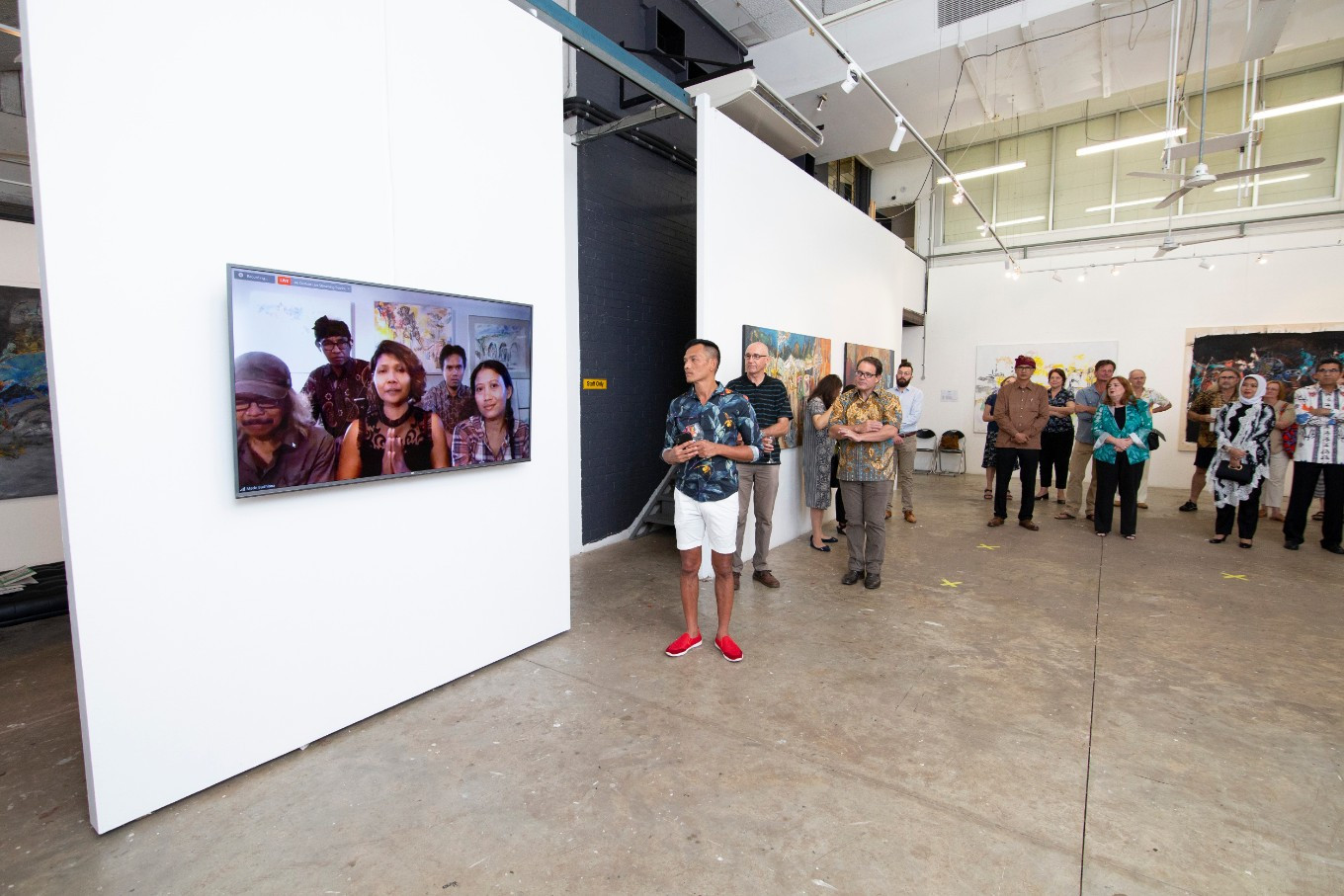 The participating Indonesian artists attend the exhibition's opening via Zoom.