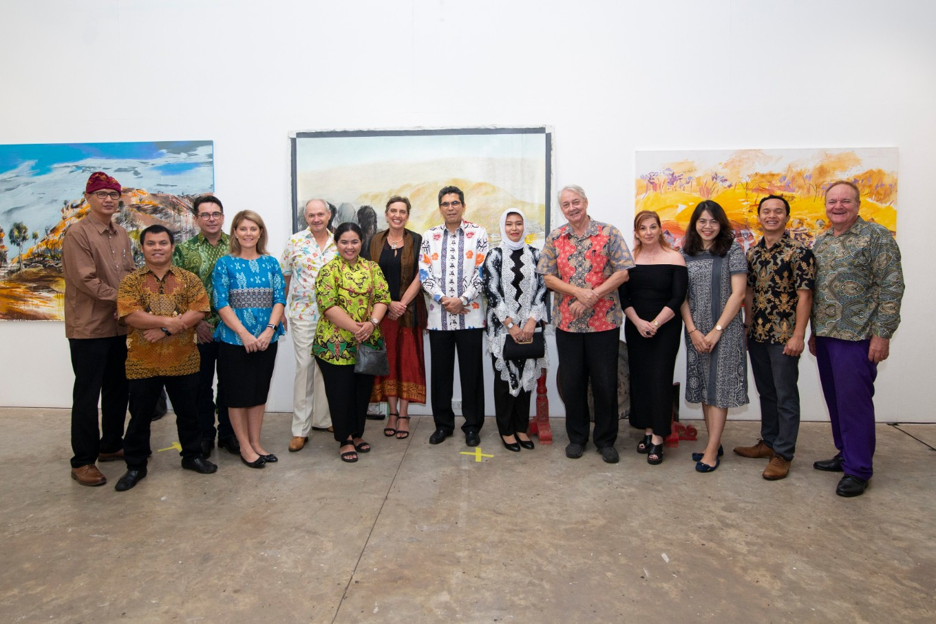 VIPs are pictured during the preview of the Artists' Camp Retrospective at the NCCA Darwin.