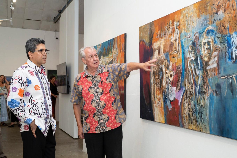 Indonesian consul to the Northern Territory of Australia Gulfan Afero with Artists' Camp Retrospective curator Colin McDonald