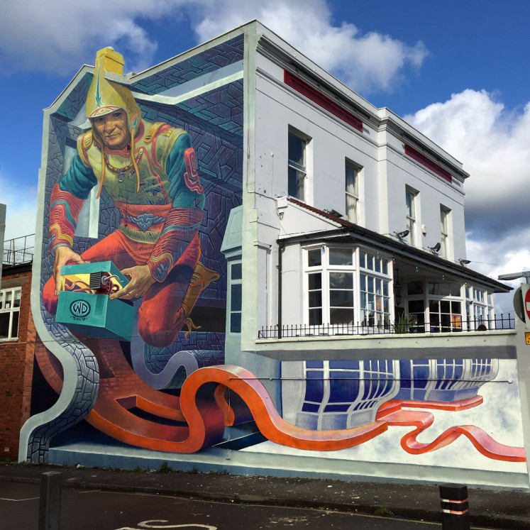 Fantastical view: Anamorphosis and 3D illusion brings perspective and fantasy to an otherwise unassuming structure mural in Cheltenham, the United Kingdom.