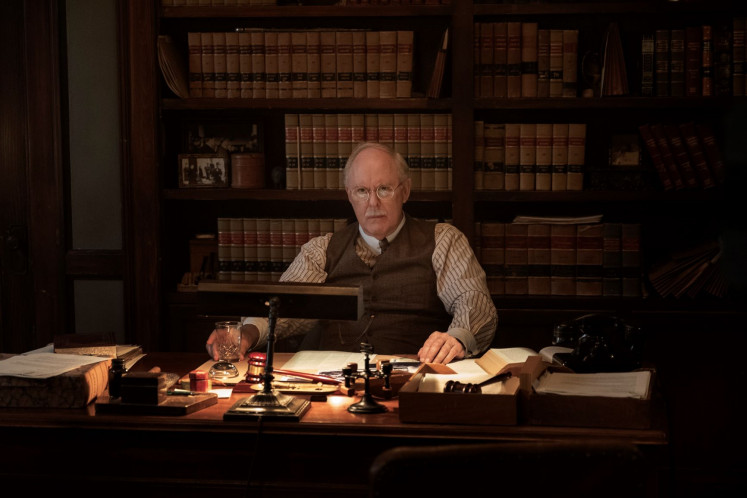 "In character: John Lithgow stars as Elias Birchard ""E.B."" Jonathan, a struggling attorney and a semi-regular employer of Penny Mason."