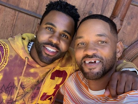 Actor Will Smith appears to have his front teeth knocked out by singer Jason Derulo