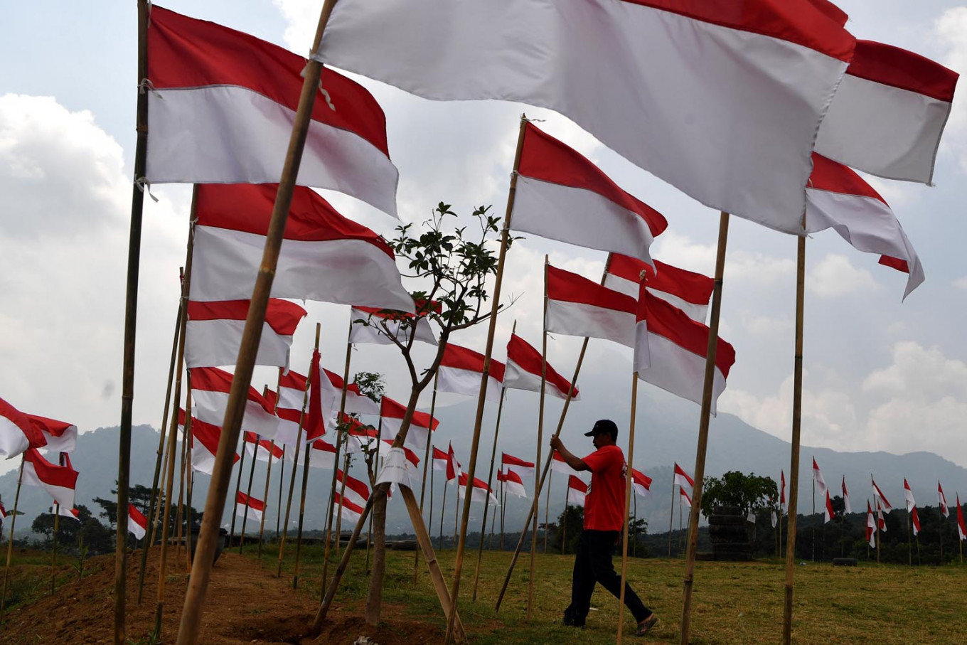 North Sumatra woman arrested for allegedly defaming national flag, president