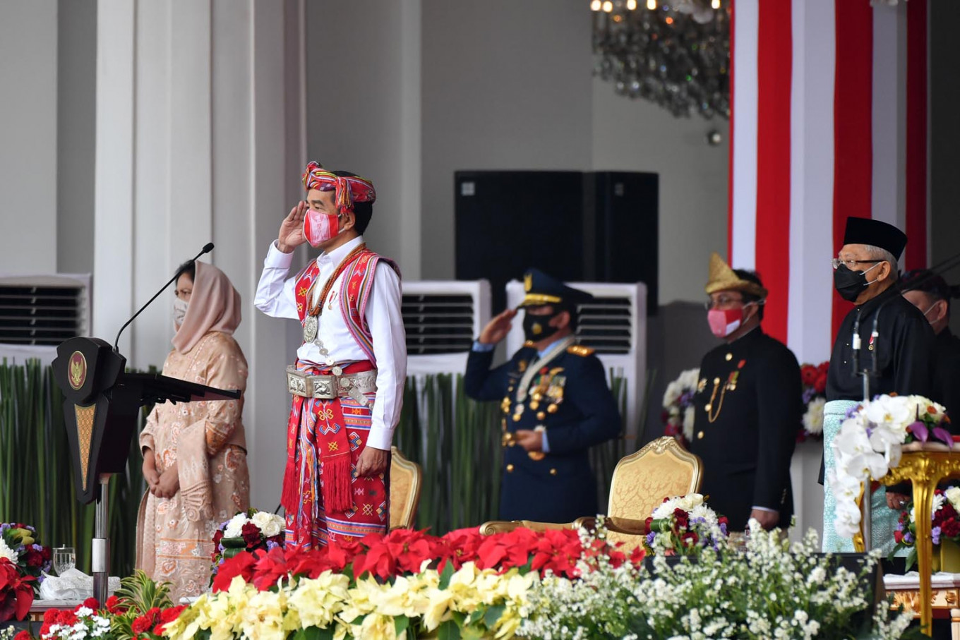Jokowi's traditional attire draws attention to forced eviction of indigenous group