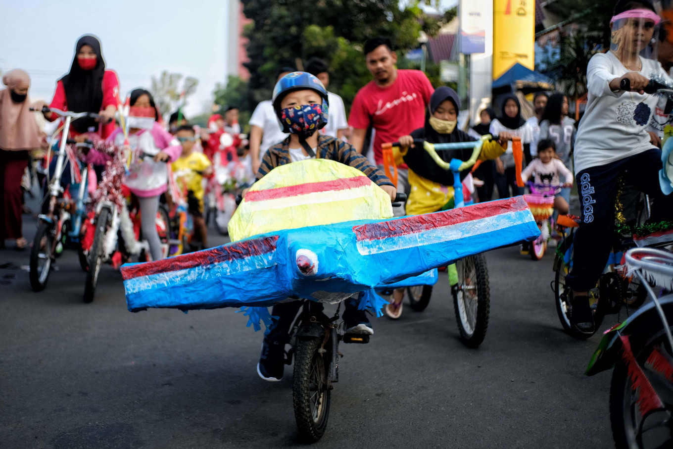Happy kids: Children take part in a parade by riding their decorated bikes in Bintaro, South Tangerang, Banten, on Monday, August 17, 2020 to commemorate Indonesia's 75th Independence Day. JP/ Seto Wardhana