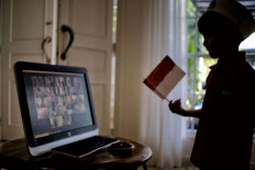 Young patriot: Rashan (5) participates in a online commemoration of the Indonesia Independence Day which is held by Al Izhar Kindergarten in Jakarta, on Monday, August 17, 2020. The Commemoration is held online to orevent further spread if the Covid 19 virus. JP/ Seto Wardhana