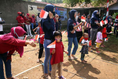 Fair play promotion: Children take part in games to commemorate Independence Day in Leuwinanggung, Depok, West Java, on Monday, August 17, 2020. The organizers required participants to abide by health protocols to prevent the spread of COVID-19. JP/P.J.Leo