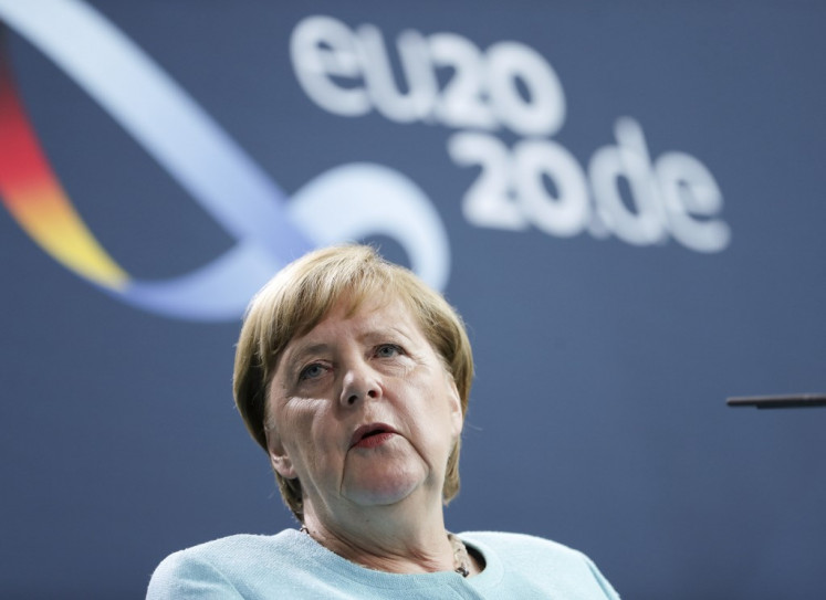 Betting on rapid tests, Germany's Merkel seeks to ease virus curbs