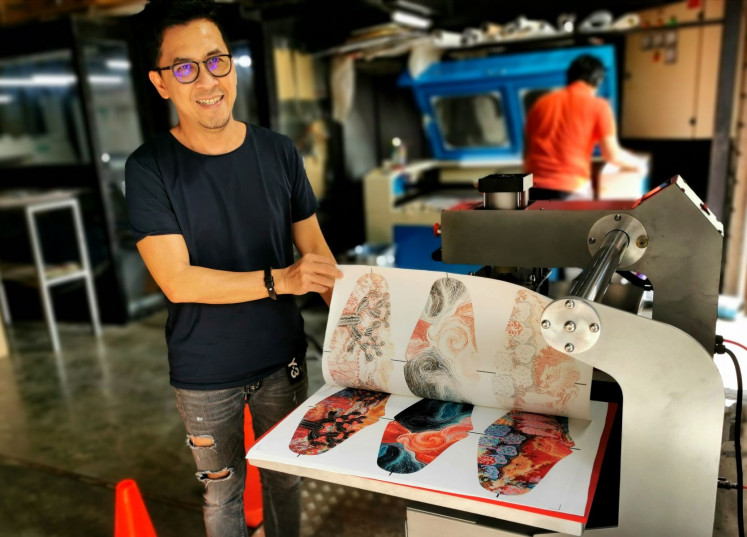 Paper to fabric: Abdes Prestaka shows the result of the heat transfer printing method during which specific designs are printed from ink-imbued paper onto fabric.