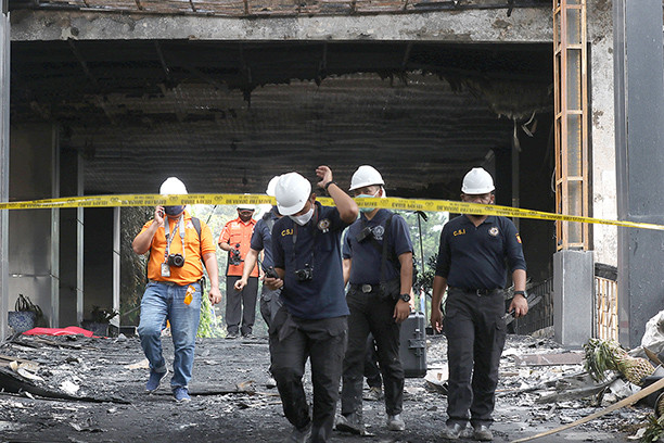 Police name eight suspects in AGO building blaze