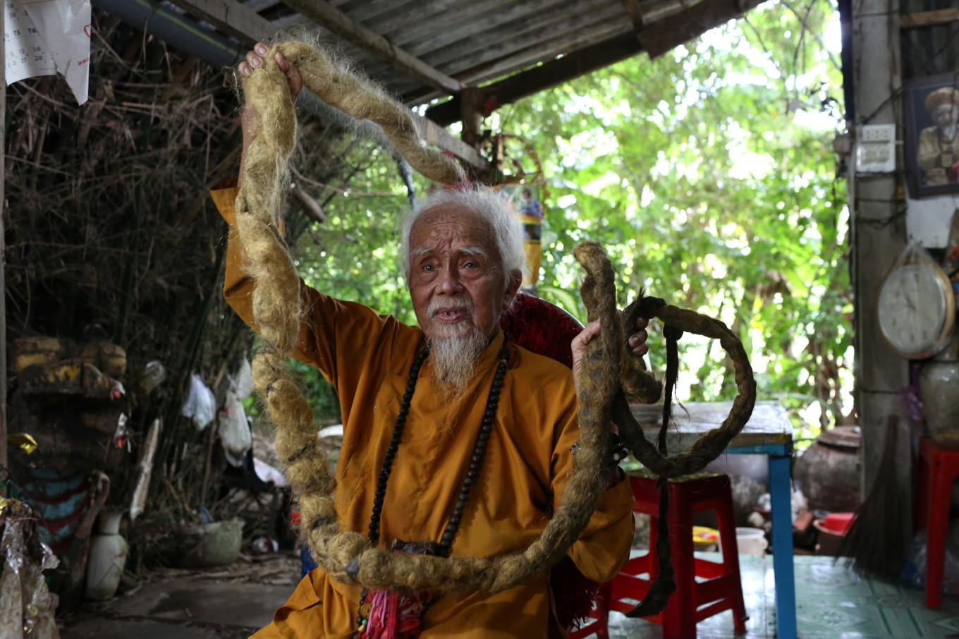 Vietnameseman with 5-meter hair says lifelong grow-out is divine calling