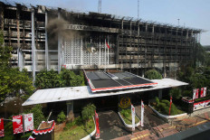The remains of the main building in the Attorney General's Office compound in South Jakarta continues to smolder on Aug. 25 after it was gutted by a fire the night before. The Jakarta Police have questioned 105 witnesses to determine the cause of the fire. JP/Wendra Ajistyatama