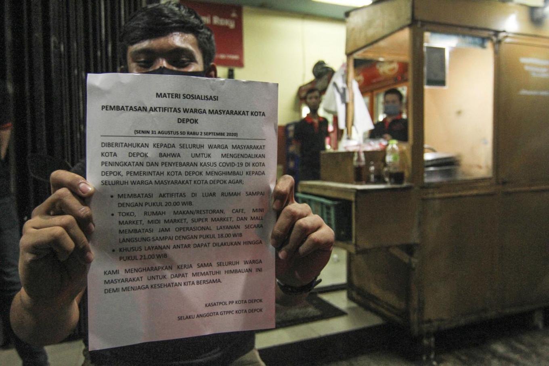 Businesses in Depok suffering under curfews, mayor mulls tweaking policy