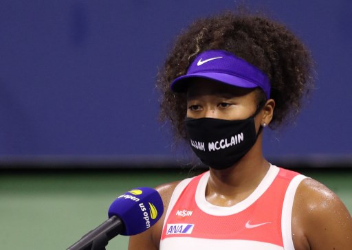 Osaka battles into last 16 of US Open