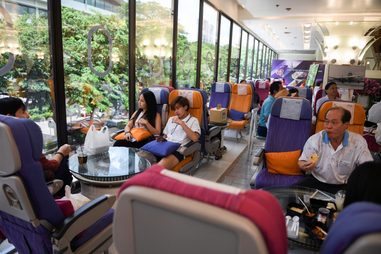 Customers eat at Thai Airways pop-up airplane-themed restaurant at the airlines headquarters with onboard meals prepared by their chefs, while their fleet is still grounded at the airport and the company awaits a bankruptcy court decision, in Bangkok, Thailand, on September 3, 2020.