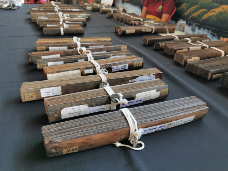 Medicine: 'Lontar Usada', palm leaf manuscripts containing ancient medicinal treatments and herbal medicines, are on display at Bulian's community hall.