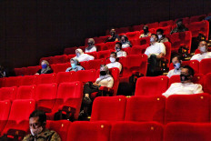 Jakarta administration officials and volunteers participate in a movie screening simulation at a Cinema XXI theater in Cililitan, East Jakarta, on Saturday. August 29. 2020. The Jakarta administration plans to allow cinemas in the city to reopen with tight health protocols. JP/Seto Wardhana