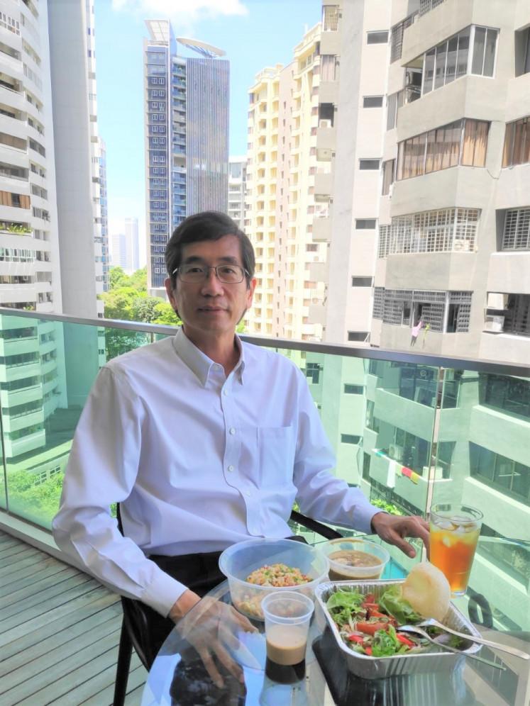 On a break: Singaporean doctor Kenny Ee Teong Tai enjoys lunch prepared by Singaporean chef George Lee Kim Teck.