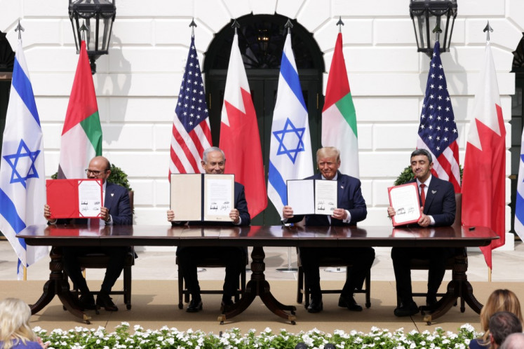 (Left to right) Foreign Affairs Minister of Bahrain Abdullatif bin Rashid Al Zayani, Prime Minister of Israel Benjamin Netanyahu, US President Donald Trump, and Foreign Affairs Minister of the United Arab Emirates Abdullah bin Zayed bin Sultan Al Nahyan participate in the signing ceremony of the Abraham Accords on the South Lawn of the White House on September 15, 2020 in Washington, DC.
