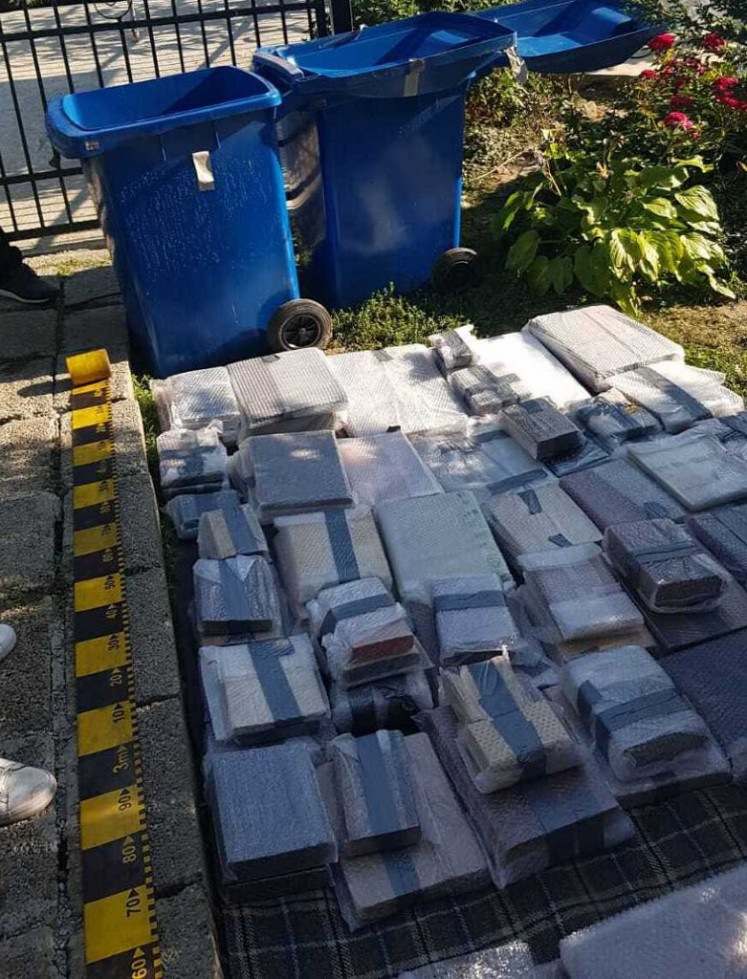 A handout picture released by the Directorate for the Investigation of Organized Crime (DIICOT) on September 18, 2020 shows books and other historical artifacts in the courtyard of a home at an undisclosed location in Neamt county in Romania, after the police recovered them.