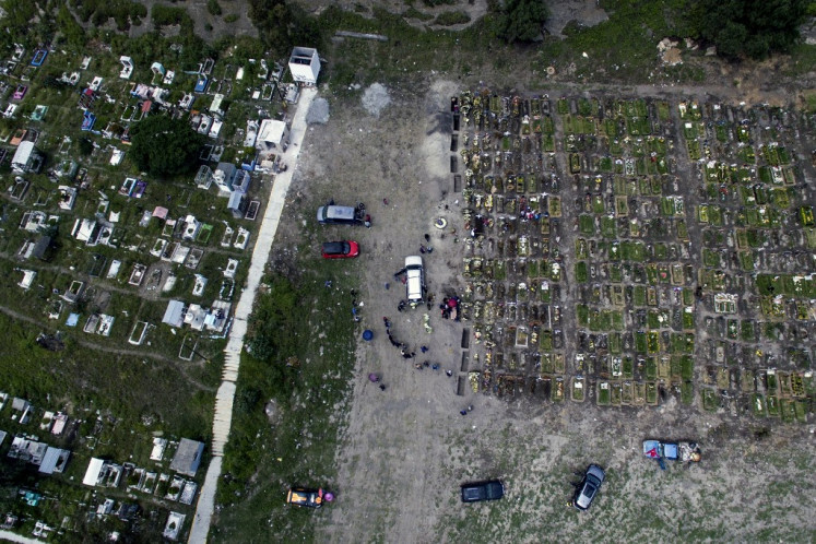 Aerial view of people attending a funeral at the Municipal Pantheon in Valle de Chalco, Mexico state, Mexico, on Thursday, amid the COVID-19 coronavirus pandemic.