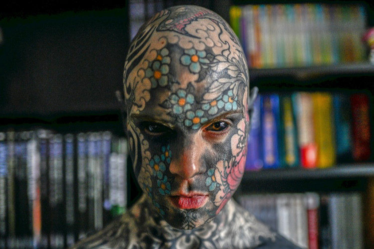 French primary school teacher and tattoo enthusiast Sylvain Helaine, known as Freaky Hoody, poses during a photo session in Palaiseau, south suburb of Paris, on September 22, 2020.