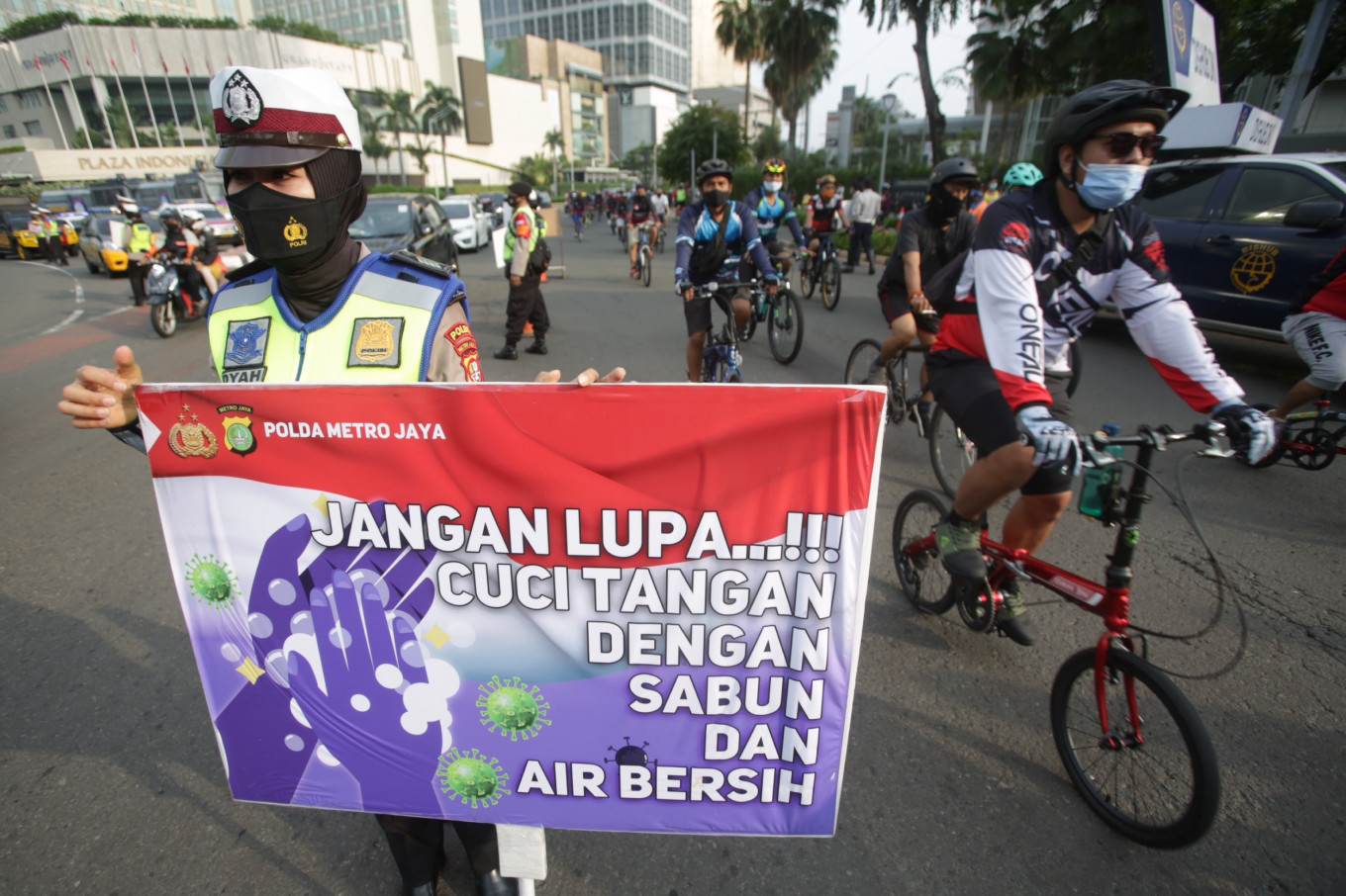Jakarta extends transitional PSBB to Dec. 21 as cases surge